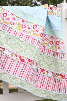 Perfect for all my leftover flannel fabric scraps! Instead of making a rag quilt with squares, make it with strips.