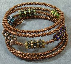 self supporting beaded beads using square stitch w peanuts and memory wire