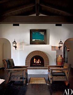 """An oil, Moonlight Mesa, from 1925, by Harold """"Buck"""" Weaver is over the fireplace, which has the same form as the one in the living room. It was inspired by an example Keaton found in a book."""