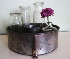 Cute idea for decor, vintage bottles in vintage bundt tin
