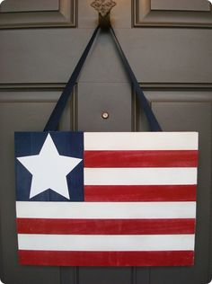 4th of July DIY flag for front door. love, but think im going to do chevron instead of the normal straight lines.
