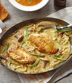 Dijon Chicken ---- 4 chicken breasts, 1C mushrooms, 1 garlic clove, 1 onion, sliced, 3T dijon mustard, 1T fresh tarragon, chopped, 2C white wine, splash of brandy