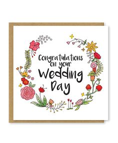 Congratulations on your wedding day. A beautiful, floral greetings card. The wreath was originally hand-drawn and painted using watercolours, it