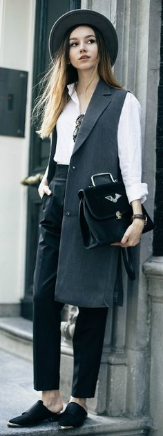 Beatrice Gutu + androgynous style + long sleeveless jacket + crisp white shirt + pair of high waisted trousers + ultra sophisticated + for either work wear or for a smart casual everyday style!   Shirt: Calvin Klein, Jacket: Zelle, Trousers: Zara, Shoes: Asos, Hat: Brixton.