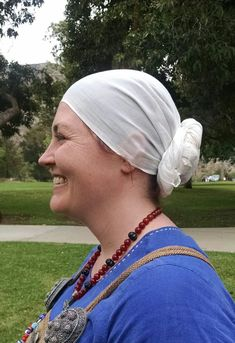Knotted headscarf. In this style the scarf is wrapped around the head, and the tails are twisted together and coiled at the base of the neck.