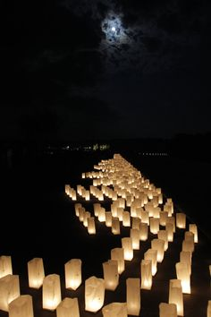 A candle-lit luminaria extends along phase 1 of the Flight 93 National Memorial near the crash site of Flight 93 in Shanksville, Pa. Sept. 10, 2011. (AP Photo/Amy Sancetta)