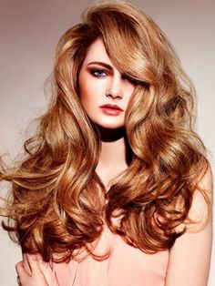 Use a round brush for blow-drying and then a curling iron to create the wavy texture. The secret of this style is to avoid curling too close to the roots.