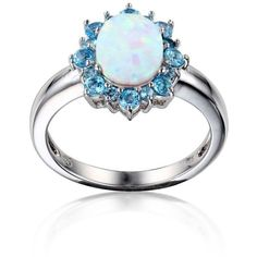 Belk  Co. Blue Rhodium Plated Created Opal  Swiss Blue Topaz Oval Halo... ($120) ❤ liked on Polyvore featuring jewelry, rings, blue, swiss blue topaz ring, imitation jewellery, enhancer ring, imitation jewelry and rhodium plated jewelry