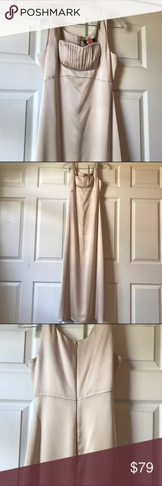 BCBGMaxAzria Champagne Formal Gown 0 Gorgeous floor length formal BCBG MaxAzria gown purchased for an event but never wore brand-new has been dry cleaned champagne color 100% polyester measures 16 inches armpit to armpit 13 inches waist across 57 inches shoulder to hem 44 inches waist to hem BCBGMaxAzria Dresses Prom