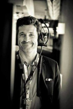 Patrick Dempsey in the Lotus GP garage.