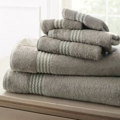 Update your bathroom routine with this luxurious towel set. This six-piece set is crafted with rayon from bamboo which naturally prevents mildew and microorganisms from growing on the towel. These bamboo fiber towels quickly absorb moisture and are perfect for a spa, workout room, or bathroom. Available in multiple colors, these towels can easily match your existing decor. Details: Set Includes: 2 bath towels, 2 hand towels and 2 washcloths 65-percent rayon from bamboo and 35-percent cotton Avai Pool Towels, Bath Towels, Pool Sizes, Beach Bath, Turkish Bath, Luxury Towels, Workout Rooms, Cotton Towels, Towel Set
