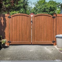 PVC vinyl Rosewood wood grain double drive gates dual leafs from IIllusions Vinyl Fence. #fenceideas #gates #fences