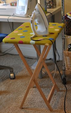 tv tray turned into ironing board to keep next to sewing machine