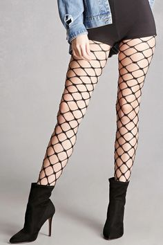 A pair of oversized fishnet tights by Leg Avenue™ in a chain link design with metallic thread and an elasticized waist.
