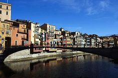 "Girona, Spain. ""This diminutive city in northern Catalonia packs a cultural punch that is the envy of many a larger destination, with a superb dining scene to match. Girona's historic quarter, a secretive jumble of medieval mansions and courtyards crowned by a magnificent cathedral, is piled up on the eastern bank of the River Ter. To the west of the river, elegant avenues laid out during the 19th century are lined with smart boutiques and cafés."""