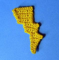 Hello there! Below is a very basic pattern for a simple Crochet Lightning Bolt Applique, Bookmark ... or whatever you can think of! I created this pattern while making items for a Harry Potter confere