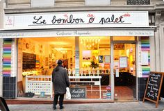 Le Bonbon au Palais, Paris. In the 5th arrondissement, the goodies are displayed in big glass vases and the shop is decorated like a 1950's school room.