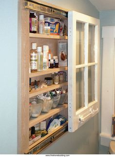 Rather than end up in a landfill, this old single-pane window has a new life as a medicine cabinet door.