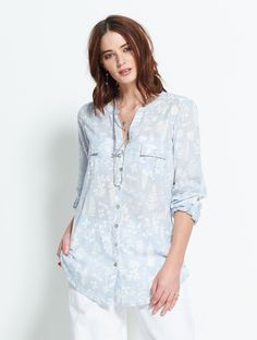 Stunning prints feature on our Cotton Shirts. This cool cotton blouse in the softest chambray has button up sleeves and front pocket details. For an easy summer look, team the Botanical print shirt with plain white from our trouser collection.