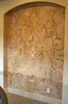 An elegant stenciled niche with a Modello Designs customized Architectural Panel masking stencil by @Patty Markison Henning of Fabulous Finishes.