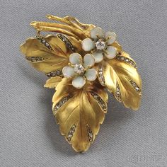 18kt Gold, Enamel, and Diamond Clip/Brooch, designed as a leaf with rose-cut diamond accents, and enamel and old mine-cut diamond flowers, 8.6 dwt, lg. 1 5/8 in.