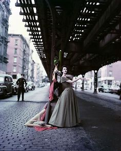 """Dovima Under the El"" (""Dior Creates Cosmopolitan Drama"") 1956 Archival Pigment Print.  William Helburn  William (Bill) Helburn is one of the great fashion photographers. A contemporary of Richard Avedon, Irving Penn, Francesco Scavullo and Lillian Bassman, Helburn was at the top of his profession from the early 1950s through the 1960s, with bylined covers and editorial images in the pages of Harper's Bazaar, Life, McCall's and many other magazines"