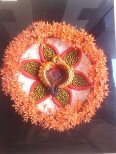Diwali flowers decorations using flowers during diwali for Aarti thali decoration with pulses