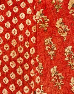 Cloak Lining of two coarser, madder-printed Indian (Gujarati) cottons - one with resist floral sprigs; one with resist diamonds in a print resembling tie-die pattern. manchestergalleries.org