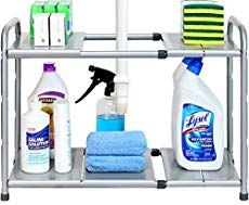 Under-sink cabinets are a hotbed for chaos, lost cleaning products, and spills that you don't remember happening. But you can tame the disorder of your under-sink cabinet with the help of an organizer. Kitchen Sink Organization, Sink Organizer, Kitchen Storage, Organization Ideas, Organized Kitchen, Storage Ideas, Shelf Ideas, Kitchen Organizers, Kitchen Drawers