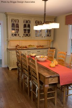 Wood is the theme of this dining room with a wooden farm table ...