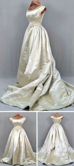 Two-piece white silk satin wedding gown, ca. 1871-80. Bodice has cap sleeves and wide scoop neck trimmed with lace front & back. Comes to point at front & back waist. Light boning & laces at back. Skirt is cartridge-pleated at sides & back and attached to muslin support with shoulder straps concealed under bodice. Long train. Towson Univ. Historic Clothing Collection