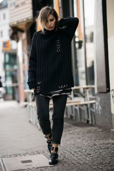Black and white striped blouse+black oversized sweater+black cropped jeans+black cut-outs ankle boots. Winter To Spring Casual Outfit 2017