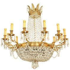 French Louis XVI style (modern) chandelier with 12 arms supported by a bronze ring with multiple beaded crystal strands converging on a bottom finial and extending to top. Bubble Chandelier, French Chandelier, Chandelier Pendant Lights, Modern Chandelier, Crystal Chandeliers, Crystal Garland, Beaded Garland, Crystal Beads, Crystals