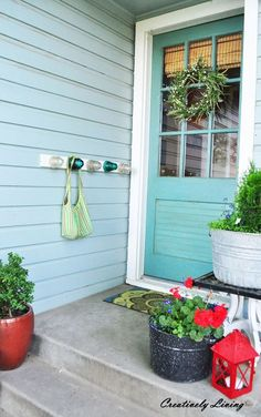 When your coat is dripping wet from rain or snow, there's no need to find a place for it to drip-dry indoors with this porch-mounted rack from Katie at Creatively Living. Vintage-style electrical insulators in colorful glass are mounted on pegs protruding from a piece of molding.