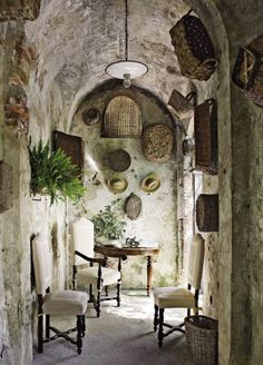 Rustic Outdoor Space by Dede Pratesi in Tuscany, Italy - like the hanging baskets on the wall and what a great escape from the hot sun.