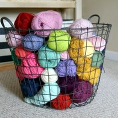 Put your yarn where you can see it in a fun oversized wire basket. It makes it easy to find that elusive ball you were looking for!   - if only i had my own craft room ... otherwise the kitties would see to it that those yarn balls are creatively scattered about the house !