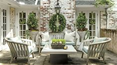 Clean and Casual - These Porches Got a Merry Makeover for the Holidays - Southern Living. Fresh colors are given a seasonal upgrade with pops of classic Christmas greenery. Ornaments add easy charm to the year-round centerpiece. Outdoor Rooms, Outdoor Living, Outdoor Decor, Outdoor Patios, Outdoor Kitchens, Outdoor Lounge, Indoor Outdoor, Back Patio, Backyard Patio