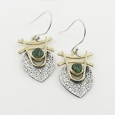 Moldavite Meteorite set in solid sterling silver three tone earrings. DETAILS: * Moldavite Meteorite Earrings * 4.6 g total weight * Set in SOLID .925 Sterling Silver & Bronze * Stamped 925 * Measures