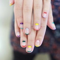 Pretty manicure with colored tips and painted moons.