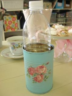 water bottle holder ... tin can by Tinkered Treasures! The Beehive Cottage   Love it for the back porch