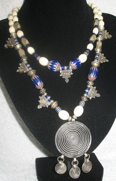 DrSpeck's Designs | Antique African Ivory beads (mid to late 1800s), Venetian 6 layer chevrons (ca 1900), Antique Berber silver beads, Antique Ethiopian silver pendants, 7 layer chevron bead (ca 1950) and a variety of other old glass beads ranging from 1950 to the early 1900s. African Trade Beads, African Jewelry, Tribal Jewelry, Indian Jewelry, Jewelry Art, Beaded Jewelry, Silver Jewelry, Beaded Necklace, Unique Jewelry