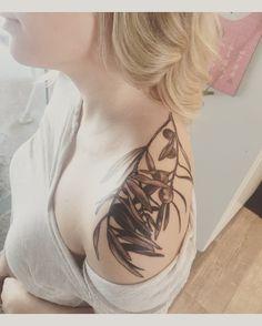 Olive branch tattoo by Sean Wright at Wonderland Tattoo. LLC: Portland, OR