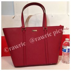"""New Kate Spade red saffiano leather large tote 100% authentic. Dynasty red saffiano leather with 14-karat light gold plated hardware. Inside zip and slip pockets. Zip top closure and fabric lining. Handles drop 9"""". Measures 19""""top/12.5""""bottom x 11"""" (H) x 6"""" (W). Brand new with tags. Comes from a pet and smoke free home. Kate Spade shopping bag included. kate spade Bags Totes"""
