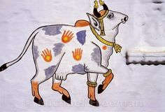 Cow mural: Painting of a sacred cow on the walls of Jagdish Temple, Udaipur, Rajasthan, India.