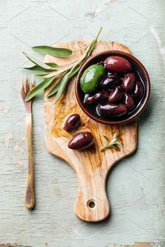 Olives with sage leaves on wooden background. Photograph оливки by Natalia Lisovskaya on Olive Recipes, Greek Recipes, Clean Eating Recipes, Food Photography Styling, Food Styling, Tapas, Greek Olives, Food Backgrounds, Fruits And Veggies