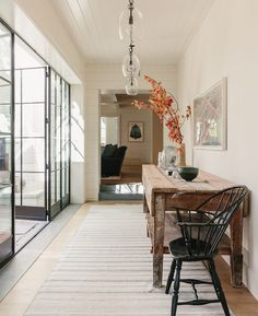 There's so much to love about this gorgeous California entryway! That rustic table along with the amazing steel and glass doors, beautiful lighting, and decor, make this space truly stunning! entryway ideas - foyer - entryway decor - entry - fall decor Hill Interiors, Amber Interiors, Interior Design Work, Interior Photo, Interior Decorating, Finding A House, Design Firms, Entryway Decor, Entryway Ideas