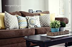 house by hoff, brown sofa, colorful throw pillows