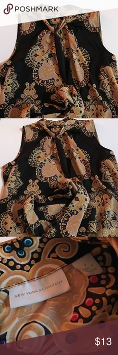 NY&Co High Neck Blouse Gently worn, great condition. High neck. Tie in front, larger bow or two strands hanging. Unique pattern. Good for office. New York & Company Tops Blouses