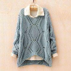 Голубой пуловер с ажурными ромбами.