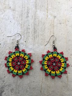 Hey, I found this really awesome Etsy listing at https://www.etsy.com/listing/271712126/huichol-beaded-earrings-175-diameter